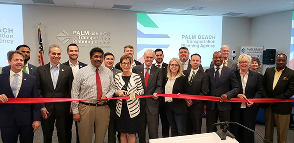 TPA Governing Board members cut a ribbon for the new TPA offices on 2/20/2020. The office is located at 301 Datura St., West Palm Beach, FL 33401.